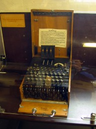 An Enigma machine with the three scrambling rotors at the top and Steckerbrett (plugboard) on the bottom front edge.
