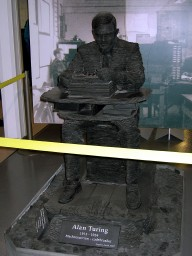 This slate statue of Alan Turing sits near the bombe that he designed.
