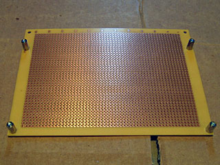 Underside of the perfboard showing PCB spacers